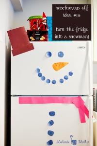 Elf on the Shelf turns the fridge into a snowman!  Elf idea #114