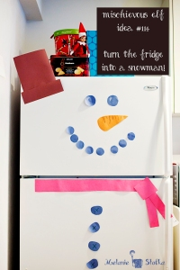 Elf on the Shelf turns the fridge into a snowman!  Elf idea #114